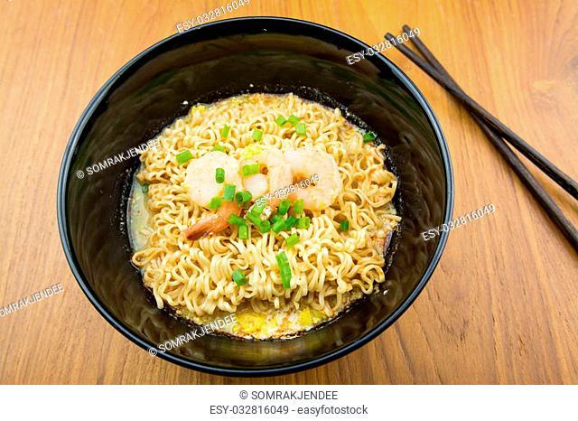 Noodles with shrimp in bowl
