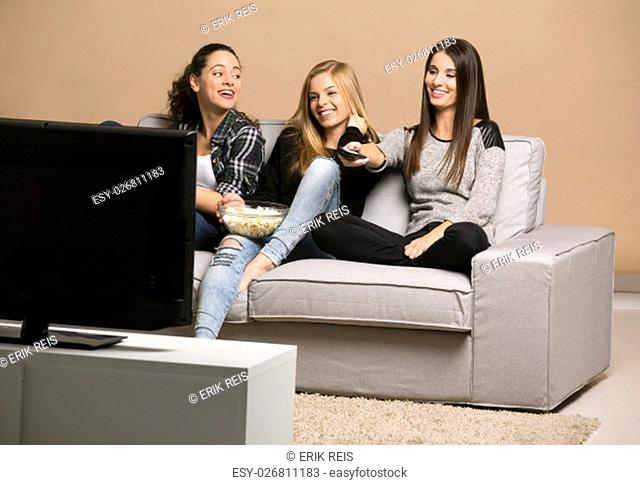 Girls watching 3D movies with popcorn