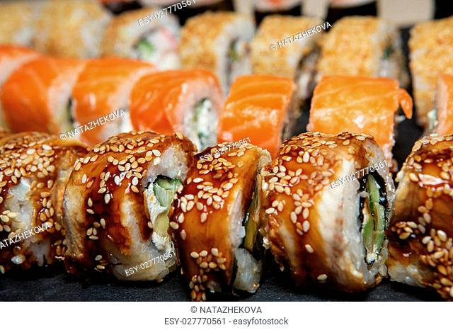 Best Types of Sushi Rolls. Philadelphia Roll, California Roll, Eel Avocado Roll. Delicious rolls and sushi with eel, salmon, shrimp, cucumber and philadelphia