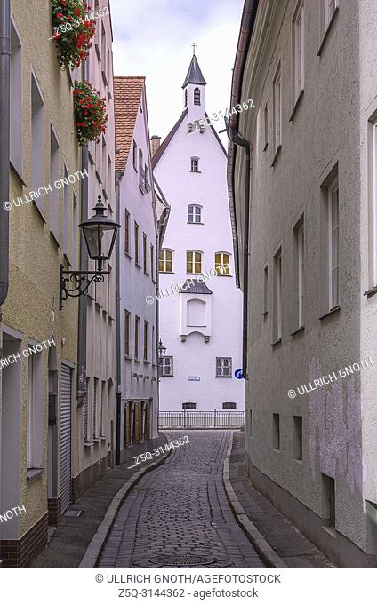 Augsburg, Bavaria, Germany - View through the narrow lane of Schleifergässchen to the monastery of the Franciscan nuns of the Star of Mary