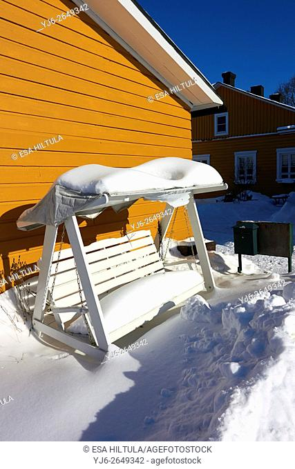 snow covered swing bench, Finland