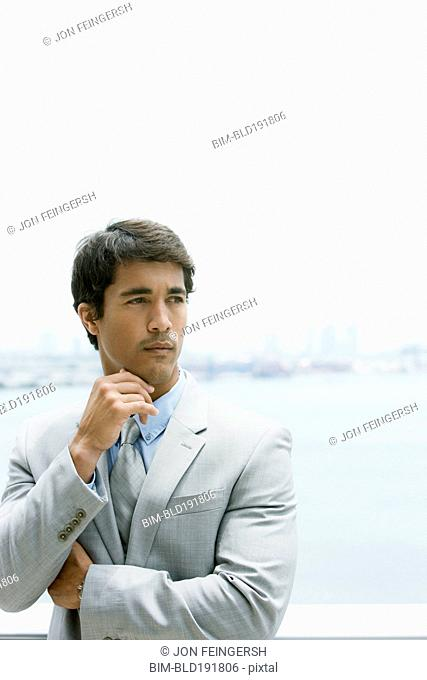Hispanic businessman looking pensive