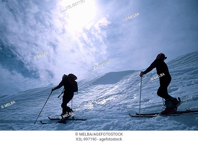 Couple cross country skiing, rear view  Pyrenees Lles  Catalonia  Spain