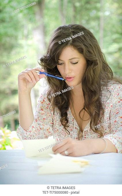 Young woman writing letter