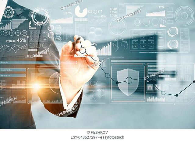 Businessman drawing abstract business chart hologram on blurry office interior background. Finance concept. Double exposure