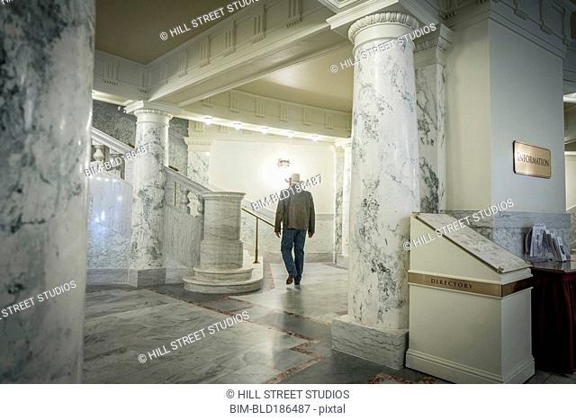 Caucasian man walking in capitol