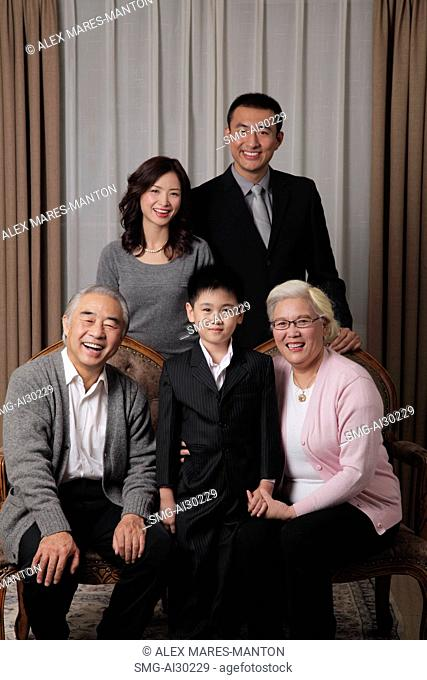 Three generational family posing for a photo together