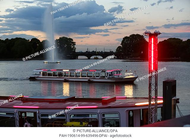 13 June 2019, Hamburg: With red and white lamps Alsterfdampfer are on the way at the Jungerfernstieg on the Binnenalster