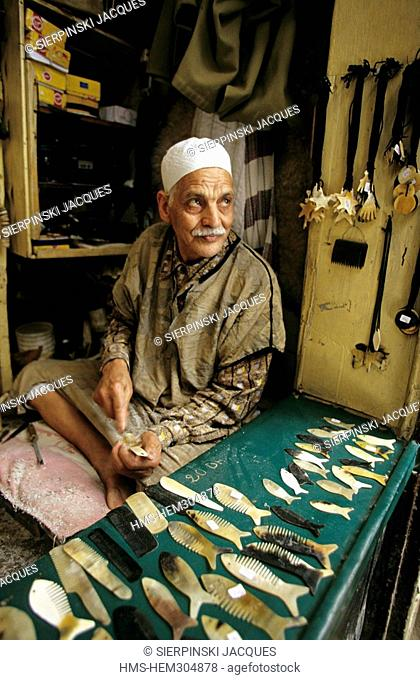 Morocco, Middle Atlas, Fez, craftman making horn objects in the medina