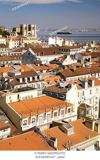 Lisbon rooftops and Tejo River viewed from Santa Justa Lift, Portugal