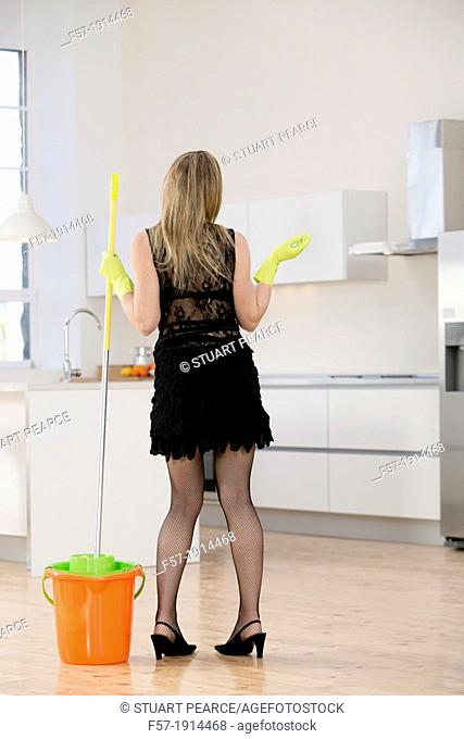 Domestic goddess mopping her kitchen