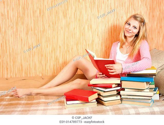 female student reading books