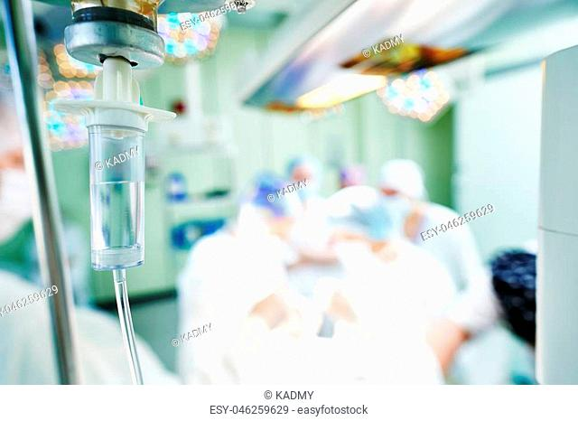 surgery. medical dropper anesthetics in front of surgical room or operating theater with surgeon team doctors performing abdoinal operation at hospital