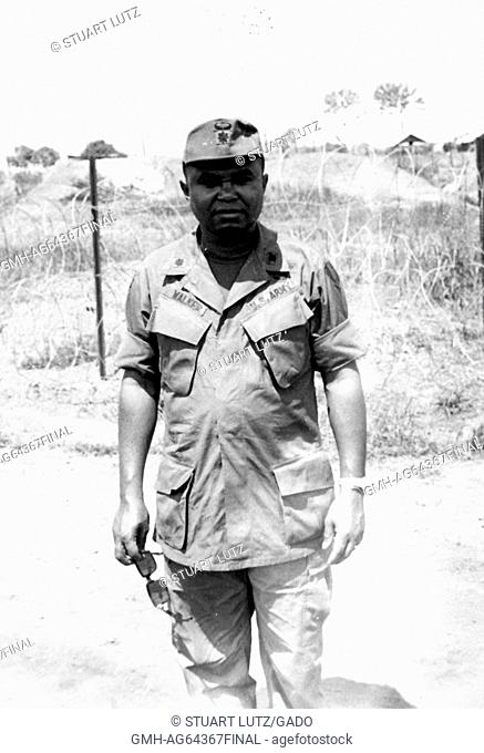 African-American United States Army Lieutenant AL Walker standing in front of barbed wire at Phuoc Vinh Base Camp, with the 1st Cavalry Division