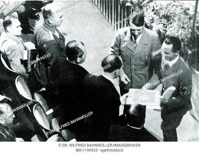 Adolf Hitler and Josef Goebbels award the national prize for art and science to Dr. Porsche, Prof. Messerschmidt and Prof. Heinkel