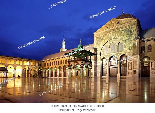 Empty courtyard of Omayyaden Mosque in the late evening with light and dark blue sky, Damascus, Syria, Middle East, Asia