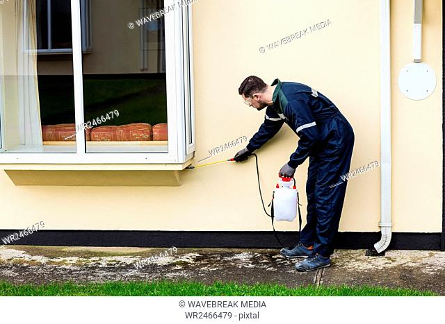 Pest control man spraying pesticide