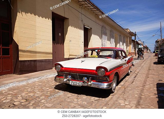 Old American car used as taxi at the cobblestone street in town center, Trinidad, Sancti Spiritu Province, Cuba, West Indies, Central America