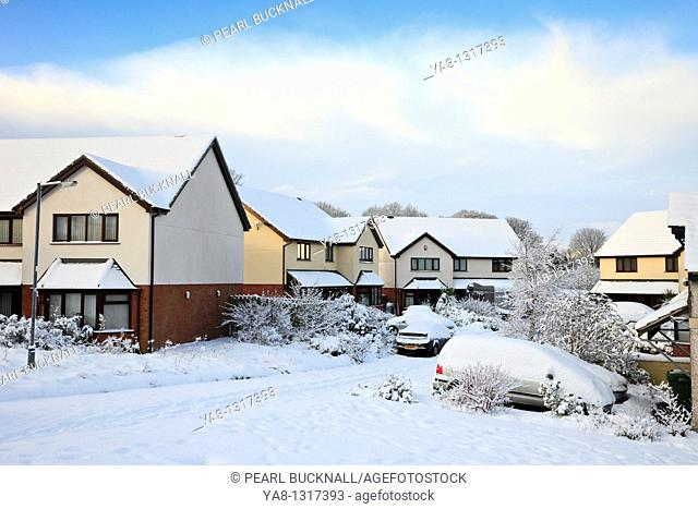 Benllech, Anglesey, North Wales, UK, Europe  Snow on suburban estate street and houses after heavy winter snowfall