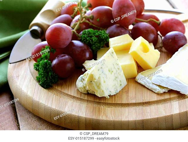 cheeseboard with cheese and grapes