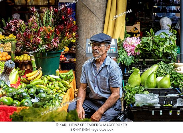 Grocer selling fruit, Market Hall, Funchal, Madeira, Portugal