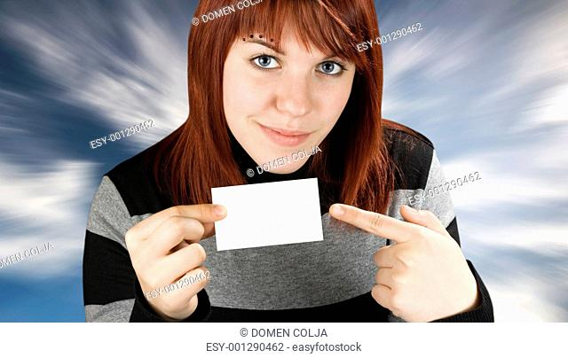 Girl pointing at a blank business card