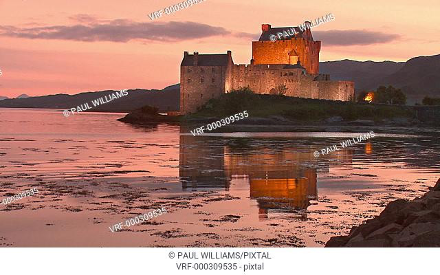 Static shot of Eilean Donan Castle at sunset, Kintail National Scenic Area, Dornie, western Highlands, Scotland