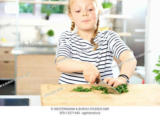Girl cuts fresh parsley