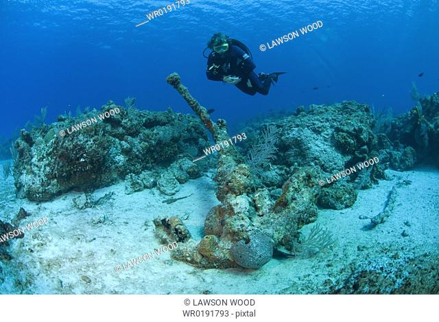 Diver and anchor from undiscovered shipwreck, Maria La Gorda, Cuba, Caribbean