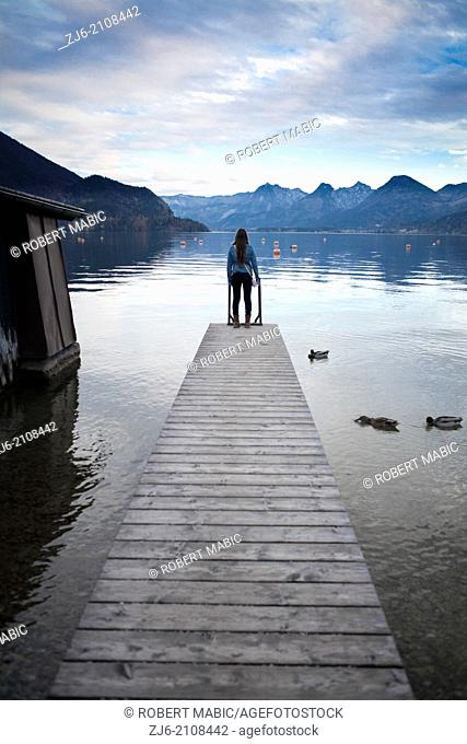 Woman standing on a pier by the Wolfgangsee lake