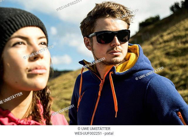 Austria, Tyrol, Tannheimer Tal, young couple in mountains