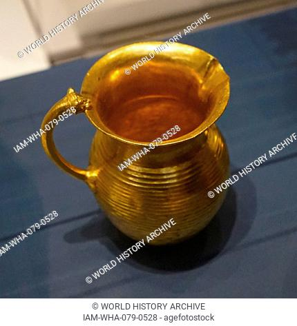 Golden jug with horizontal fluting, typical of Achaemenid metal work. Dated 5th Century BC