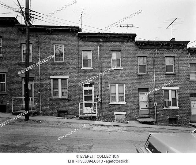 Yonkers, New York, ca. 1980. Moquette Row Housing was built between 1886 and 1889. Each bonds to its neighbors in a continuous row along the hill slope
