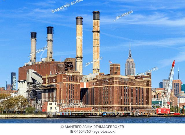 Con Edison power station, Empire State Building at back, East River, Manhattan, New York City, New York, USA