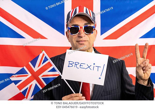 British male businessman with Brexit banner and UK flag