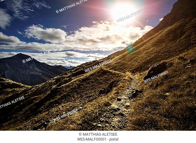 Germany, Allgaeu Alps, man on mountain trail