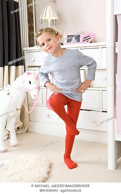 Girl wearing tights in her room