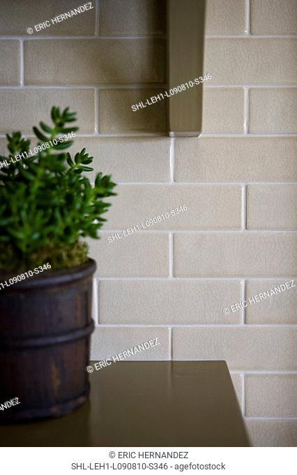 Wooden shelf bracket against tile wall