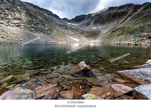 Clear waters of Ledenoto (Ice) Lake and Musala Peak, Rila mountain, Bulgaria