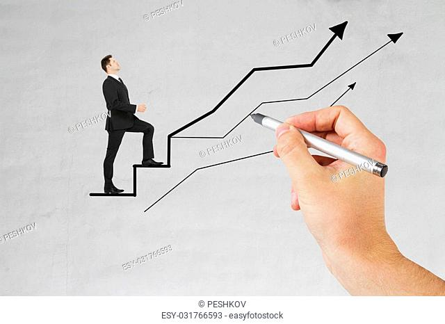 Businessman walking on chart arrows drawn by male hand on concrete background. Success concept
