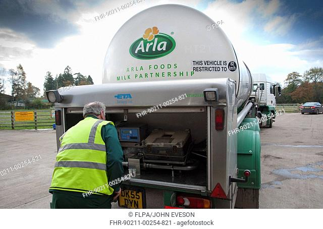 Arla milk tanker loading milk at dairy farm, man with milk samples, Dumfries, Scotland