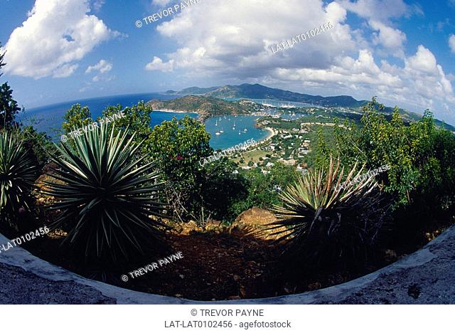 View over English Harbour. Buildings of town. Harbour. Boats moored. Fish eye lens