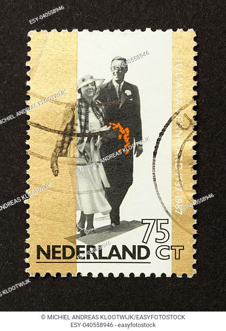 HOLLAND - CIRCA 1970: Stamp printed in the Netherlands shows the king and queen (Beatrix), circa 1970