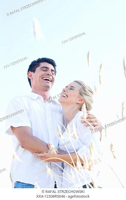 couple walking through the crop