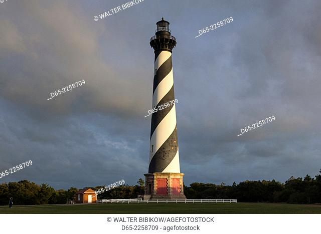 USA, North Carolina, Cape Hatteras National Saeshore, Buxton, Cape Hatteras Lighthouse, b. 1870, tallest brick structure in the US, sunset