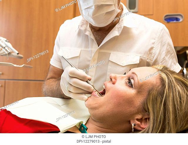 Female patient at dental appointment; Edmonton, Alberta, Canada