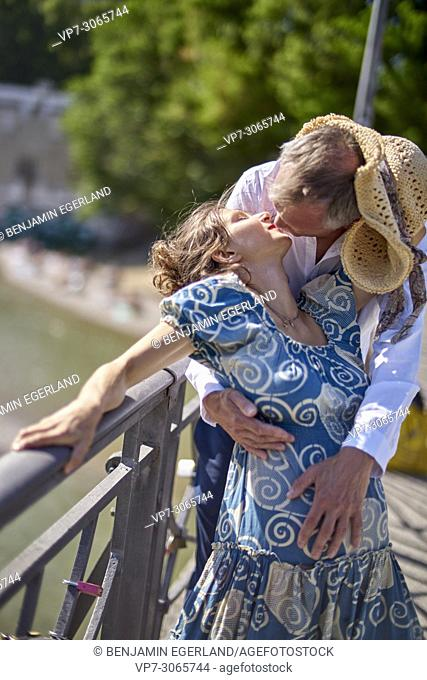 Couple kissing, pregnancy, age difference. Munich, Germany