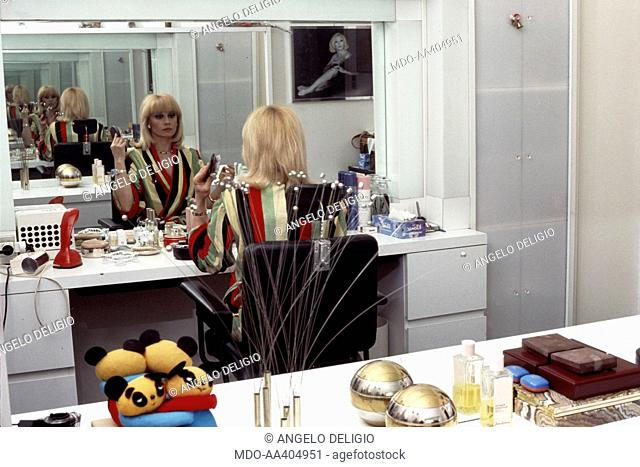 Raffaella Carrà making up. Italian TV presenter, actress, singer and showgirl Raffaella Carrà (Raffaella Maria Roberta Pelloni) making up in her dressing room