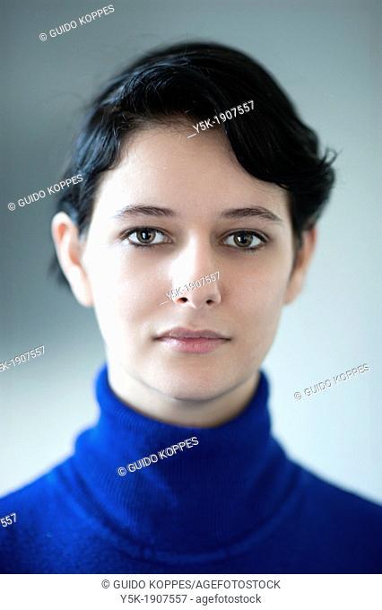 Tilburg, Netherlands. Soft studio-portrait of a young brunette