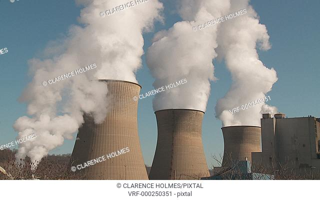 Hyperboloid cooling towers emit steam at the Bruce Mansfield Power Station, a coal-fired power station owned and operated by FirstEnergy on the Ohio River near...